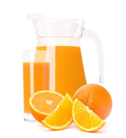 Orange fruit juice in glass jug isolated on white background cutout photo
