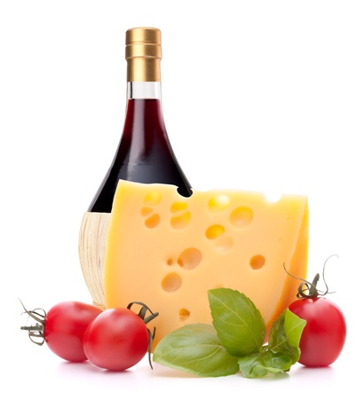 Red wine bottle, cheese and tomato still life isolated on white background cutout. Italian food concept. photo