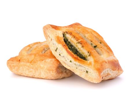 Puff pastry bun isolated on white background. Healthy patty with spinach. photo
