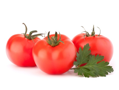 Three tomato vegetables and parsley leaves still life isolated on white background cutout photo