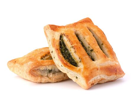 spinage: Puff pastry bun isolated on white background. Healthy patty with spinach.