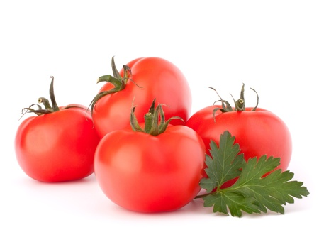 Tomato vegetables and parsley leaves isolated on white background cutout photo