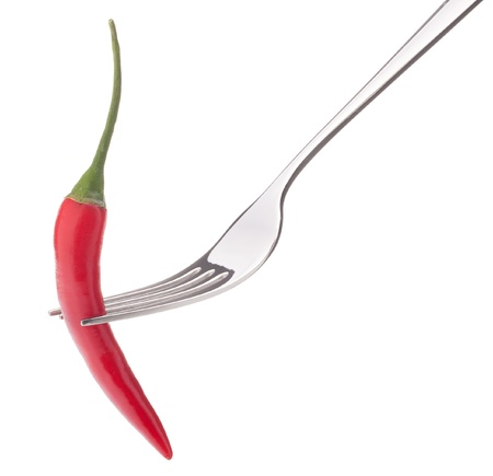 Chili pepper i on fork isolated on white background cutout. Healthy eating concept. photo