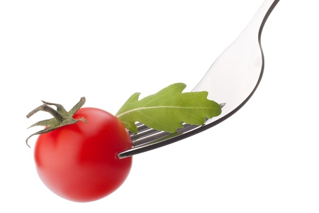 Fresh rucola  salad and cherry tomato on fork isolated on white background cutout. Healthy eating concept. photo