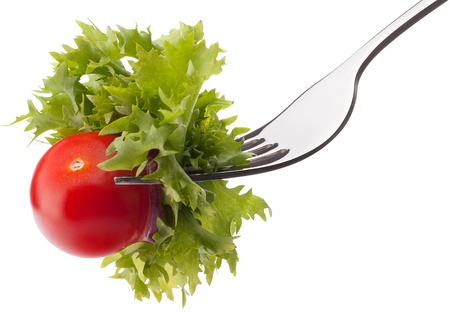 Fresh salad and cherry tomato on fork isolated on white background cutout. Healthy eating concept. photo