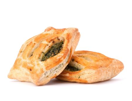 patty: Puff pastry bun isolated on white background. Healthy patty with spinach.