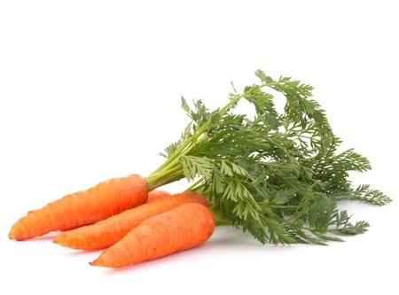白い背景の切り欠きに分離した葉と野菜なニンジン 写真素材