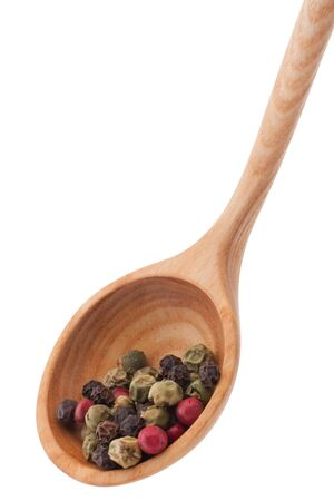 Pepper seasoning  mix in wooden spoon isolated on white background cutout photo