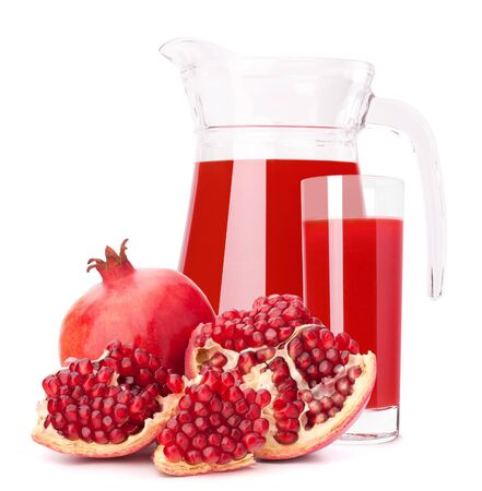 Pomegranate fruit juice in glass pitcher isolated on white background cutout photo