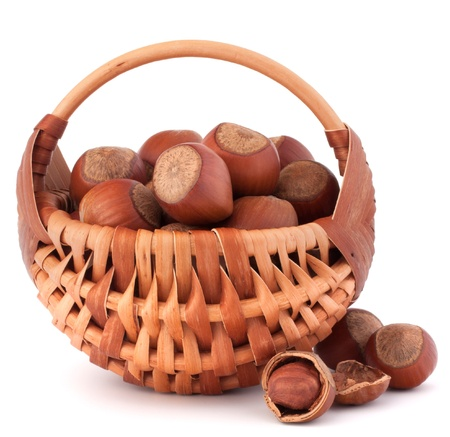 willow fruit basket: Hazelnuts in wicker basket isolated on white background Stock Photo
