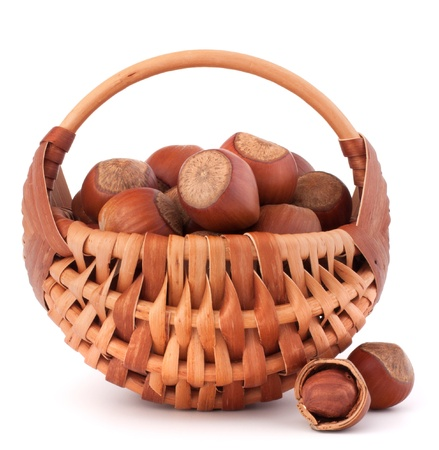 full willow: Hazelnuts in wicker basket isolated on white background Stock Photo