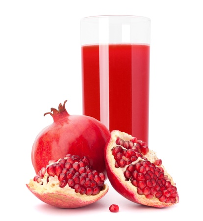 pomegranates: Pomegranate fruit juice in glass isolated on white background cutout Stock Photo