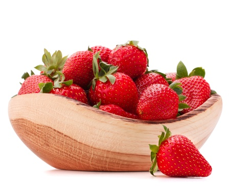 Strawberries in wooden bowl isolated on white background cutout photo