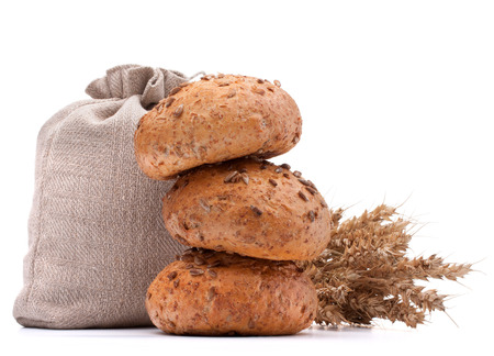 Meal sack, bread rolls and ears bunch still life isolated on white background cutout photo