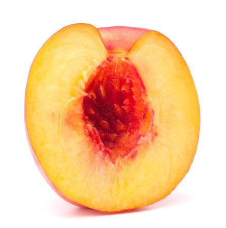 velvety: Nectarine fruit half isolated on white background cutout