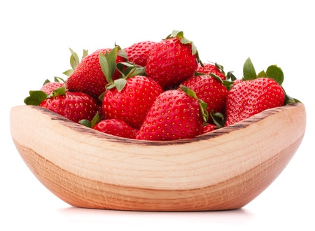 Strawberries in wooden bowl isolated on white  photo