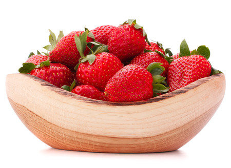 Strawberries in wooden bowl isolated on white cutout photo