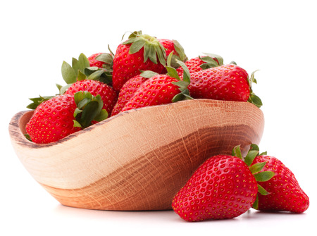Strawberries in wooden bowl isolated on white background photo