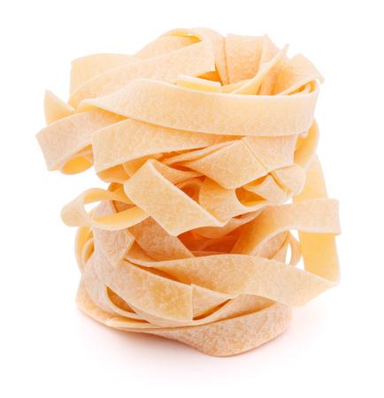 maccheroni: Italian pasta fettuccine nest isolated on white