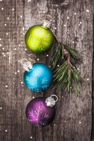 Christmas decoration ball on textured grungy wooden surface photo