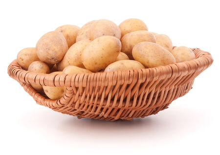 Potato tuber  in wicker basket isolated on white background photo