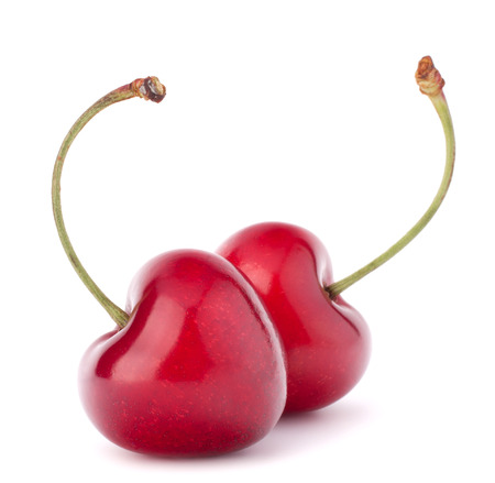 Two heart shaped cherry berries isolated on white background photo