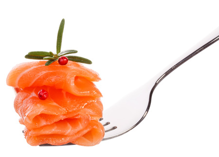 slightly: Salmon piece on fork isolated on white background  Stock Photo