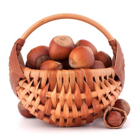full willow: Hazelnuts in wicker basket isolated