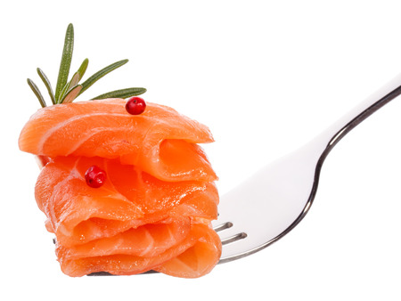 Salmon piece on fork isolated on white background cutout photo
