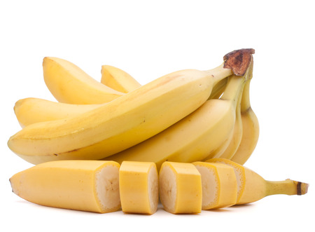 flesh colour: Bananas bunch isolated on white background cutout Stock Photo