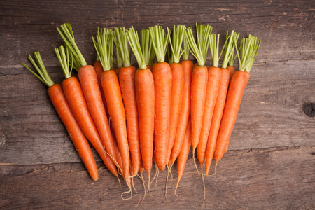 carrot: fresh carrot bunch on grungy wooden background