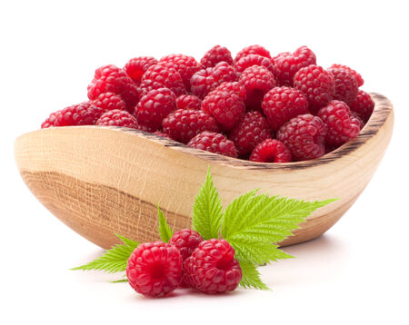 raspberries in wooden bowl isolated on white background cutout photo