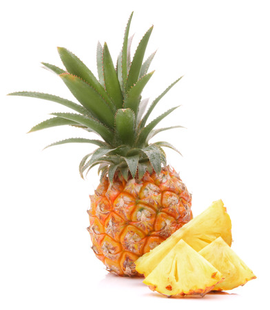 Pineapple tropical fruit or ananas isolated on white background cutout photo