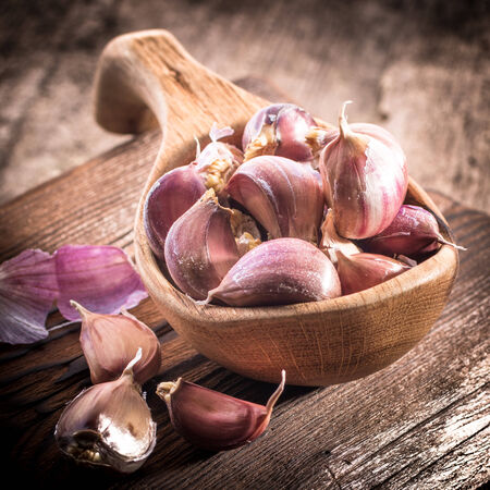 garlic bulb on rustic wooden background photo
