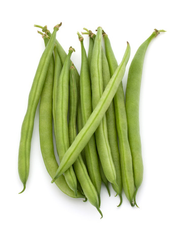 attacked: Green beans handful isolated on white background cutout Stock Photo