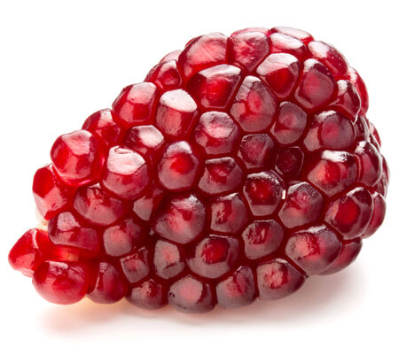 a pomegranate: Ripe pomegranate fruit segment isolated on white background cutout