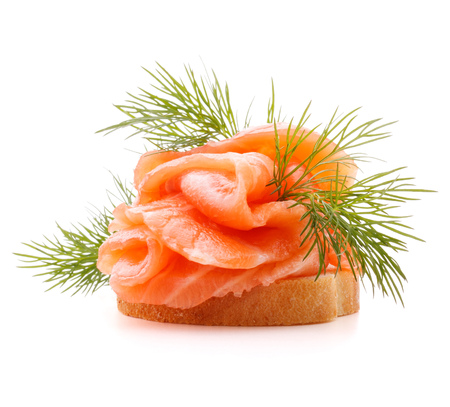 mouthful: sandwich or canape with salmon on white background  cutout