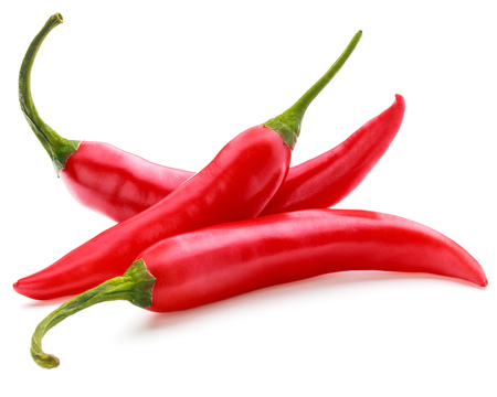 chillies: red chili or chilli cayenne pepper isolated on white  background cutout