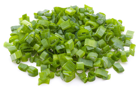 scallion: chopped spring onion or scallion isolated on white background cutout