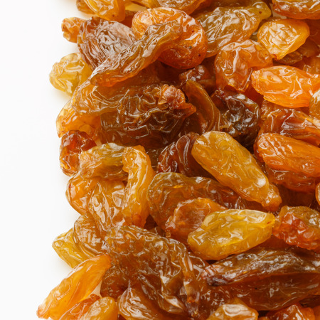 sultanas: Yellow sultanas raisins isolated on white background cutout