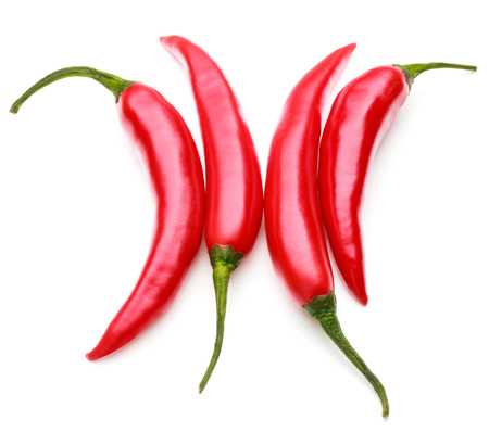 red chilies or chilli cayenne pepper isolated on white background