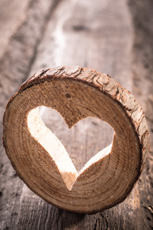 Light  heart on rustic wooden background photo