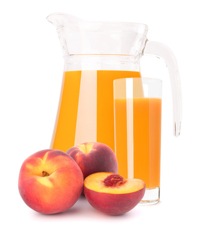 Peach fruit juice in glass jug isolated on white background photo