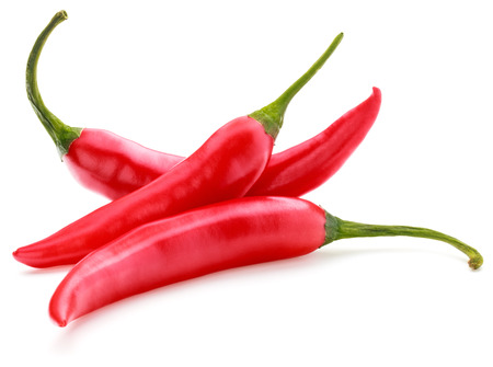red chilies or chilli cayenne peppers isolated on white background Banque d'images