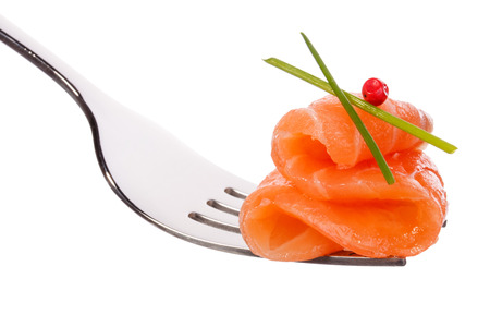 slightly: Salmon piece on fork isolated on white background cutout