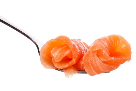 mouthful: Salmon piece on fork isolated on white background cutout