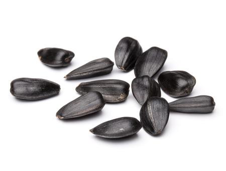 semillas de girasol: Las semillas de girasol aislados en el fondo blanco de cerca