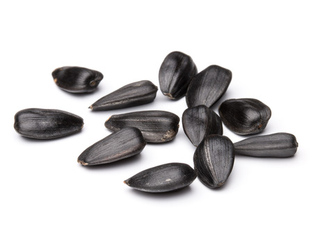 Sunflower seeds  isolated on white background close up Banco de Imagens