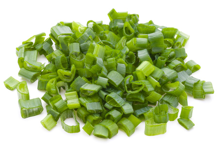 scallion: chopped spring onion or scallion isolated on white background cutout