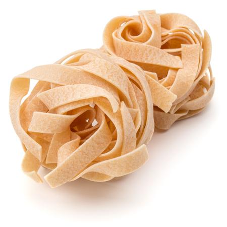 fettuccine: Italian pasta fettuccine nest isolated on white background